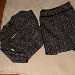 Cute Tweed suit with metal and leather accents